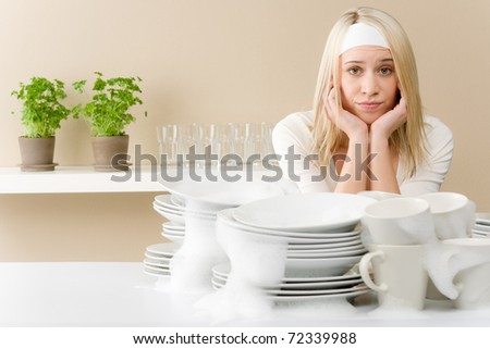 Modern kitchen - frustrated woman in kitchen, fed up - stock photo