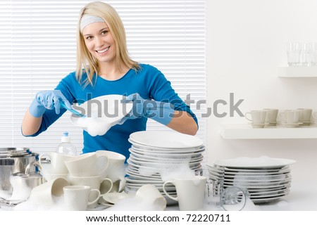 Modern kitchen - happy woman washing dishes, housework