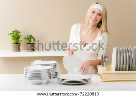 Modern kitchen - happy woman washing dishes, housework - stock photo
