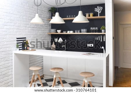 Modern kitchen in a luxurious apartment - stock photo