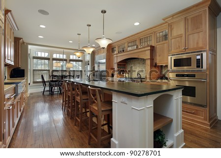 Modern kitchen in luxury home with large island - stock photo