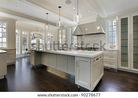 Modern kitchen in new construction home with island - stock photo