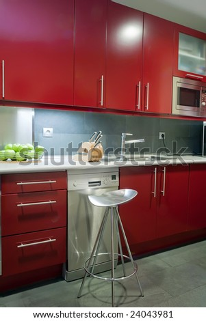 modern kitchen in red and grey colors - stock photo
