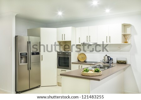 Modern kitchen in suburban house - stock photo