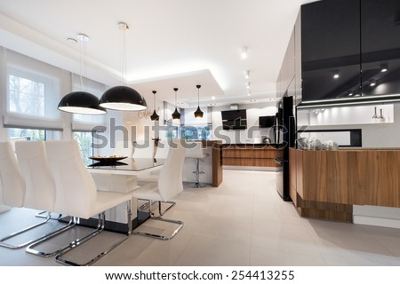Modern kitchen interior design in black and white style - stock photo
