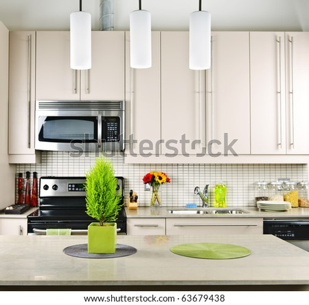 Modern kitchen interior with natural stone countertop - stock photo