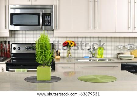 Modern kitchen interior with natural stone countertop - stock photo