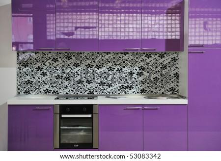 modern kitchen interior with pink furniture - stock photo