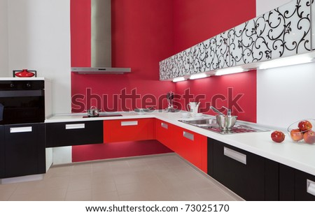 Modern kitchen interior with red decoration - stock photo