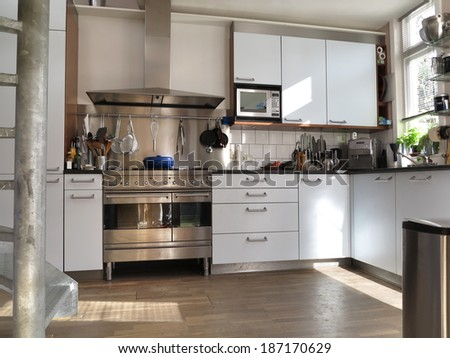 Modern kitchen interior with sunlight on wooden flor - stock photo