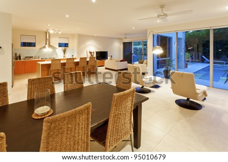 Modern kitchen, living room and dining table - stock photo