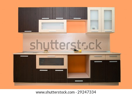 Modern kitchen on orange background - stock photo
