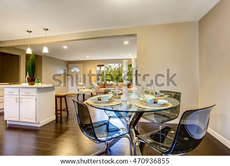 Modern Kitchen Room Interior With White Cabinets Stainless Steel Island And Serving Dining Table