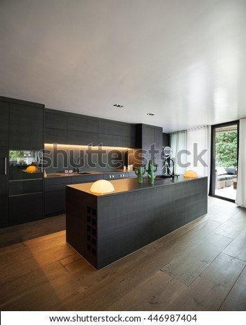 wooden furniture for kitchen. Modern Kitchen With Black Furniture And Wooden Floor For