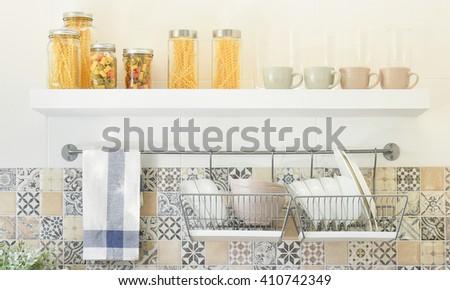 modern kitchen with ceramic kitchenware and utensils on the shelf - stock photo