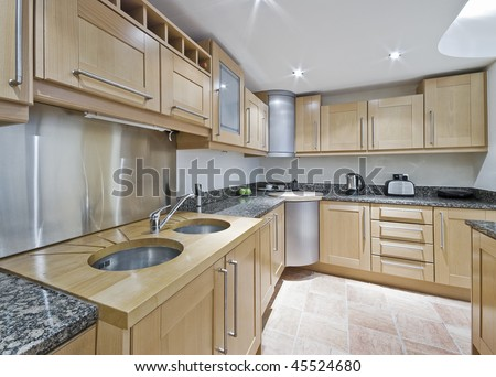 modern kitchen with double sink and accessories - stock photo