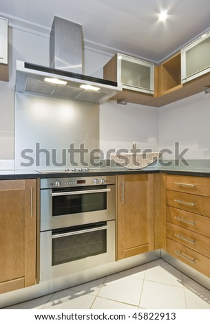 modern kitchen with electric appliances and white food basket - stock photo