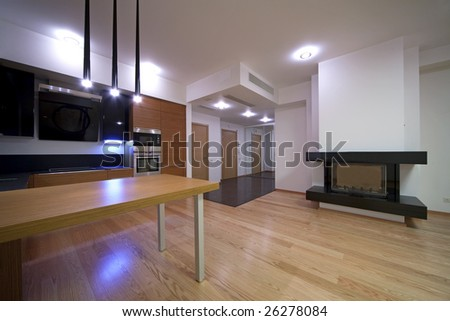 Modern kitchen with fireplace - stock photo