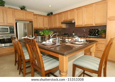 Modern kitchen with granite counter tops - stock photo