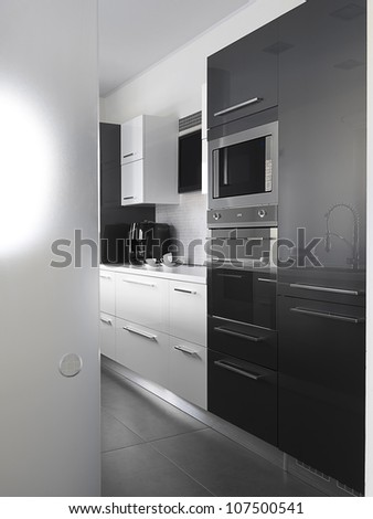 modern kitchen with gray tile floor and white wall - stock photo