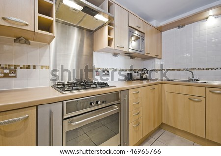modern kitchen with hard wood unit and worktop - stock photo