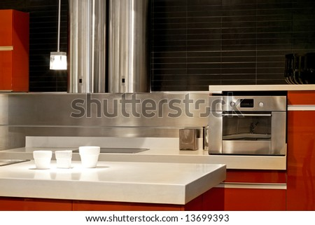 Modern kitchen with metallic oven and ventilation
