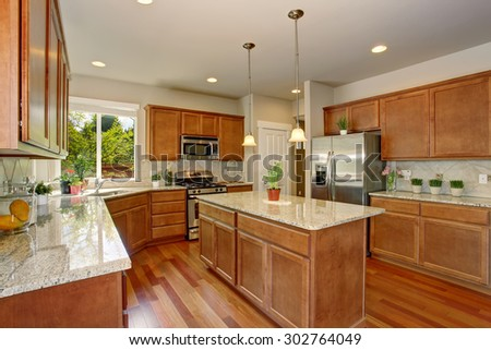 Modern kitchen with minimal decor, and hardwood floor. - stock photo