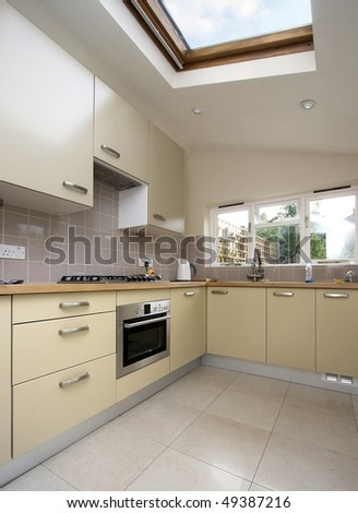 Modern kitchen with roof window - stock photo