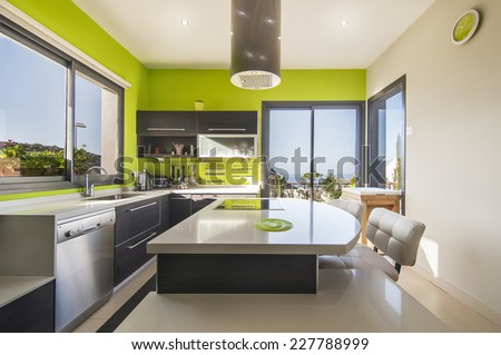 Modern kitchen with sea view - stock photo