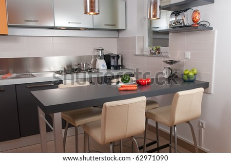 Modern kitchen with stylish appliances and cabinets - stock photo