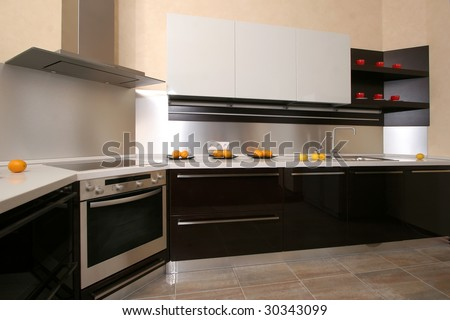 Modern kitchen with the built in home appliances - stock photo
