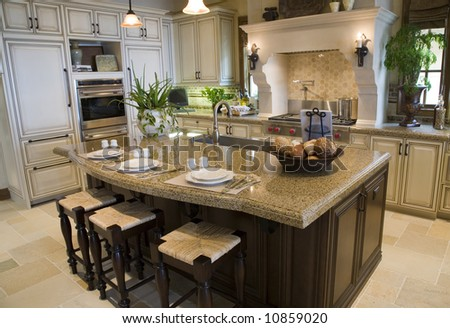Modern kitchen with tile floor and island. - stock photo