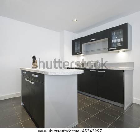 modern kitchen with work isle in the middle - stock photo