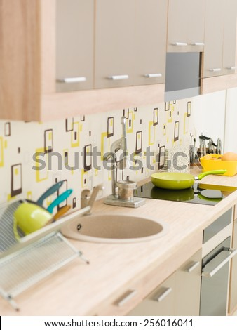 modern kitchen, wooden counter top with sink and appliances - stock photo