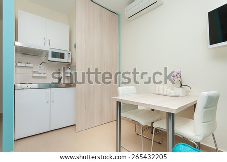 modern kitchenette  and dining room - stock photo