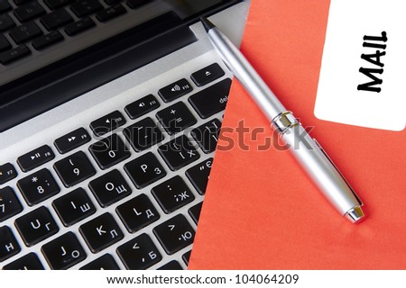 modern laptop and post envelope MAIL with pen - stock photo