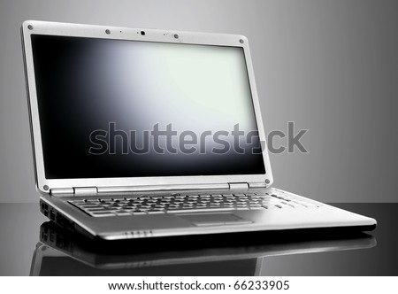 Modern laptop isolated on black background - stock photo