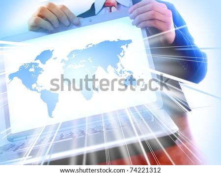modern laptop isolated on white background. World in monitor - stock photo