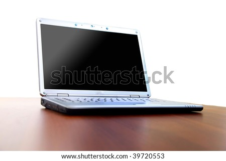 Modern laptop isolated on white with reflections on glass table.