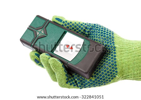 Modern laser measuring level in hand with glove isolated on white background. - stock photo