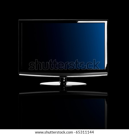 Modern lcd TV isolated over a black background with reflection - stock photo
