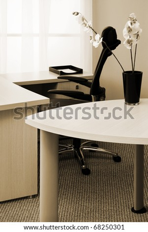 Modern leather armchair on a background of a window - stock photo