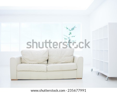 modern leather sofa in white living room - stock photo