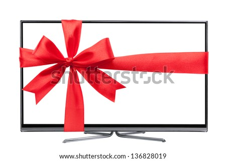 Modern Led tv with a red Christmas ribbon - stock photo