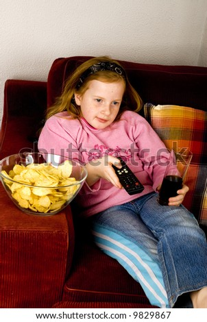 modern life while looking television with junkfood and cola - stock photo