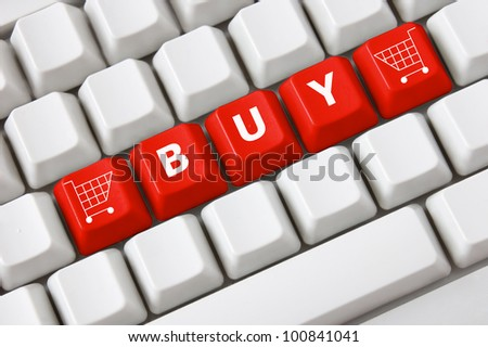 Modern light computer keyboard with a buy text and shopping cart symbol on buttons. Shopping concept - stock photo