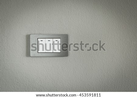 Modern Light Electrical Switch With Gray Cement Wall Background