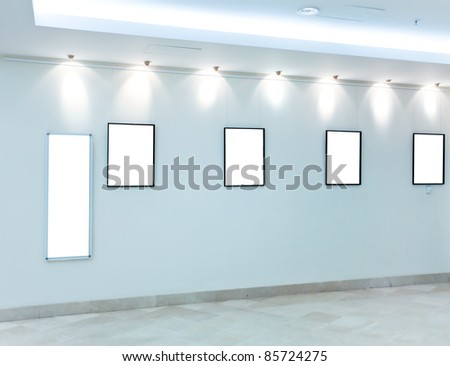 modern light hall with empty placards on the wall - stock photo