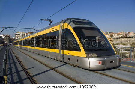 Modern light rail trolley at Porto city in Portugal. - stock photo