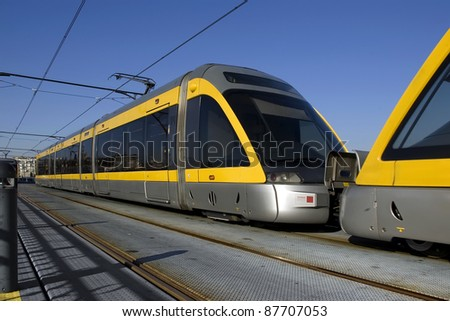 Modern light rail trolley at Porto city in Portugal.More in my gallery. - stock photo